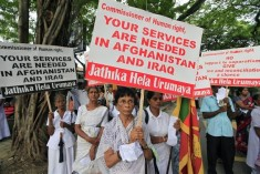 Protesters led by Buddhist monks oppose UN human rights officials' visit to Sri Lanka