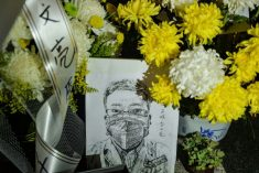 Death of whistleblower ignites calls for political reform in China