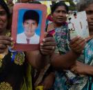 Facing Sri Lanka's Ghosts; With thousands still missing, Sri Lanka's postwar progress comes to a halt.