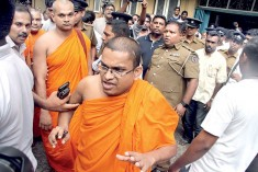 Protected by police, monks led  mob becomes violent