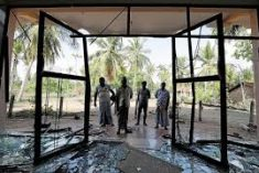 Sri Lanka clashes kill one; imposes nationwide curfew after mosques attacked