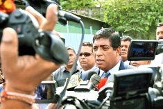 Sri Lanka former FM grilled over a bond scam and conflict of interests