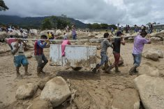 Photo Essay: The pain and sadness in the air; Covering the Colombian landslide